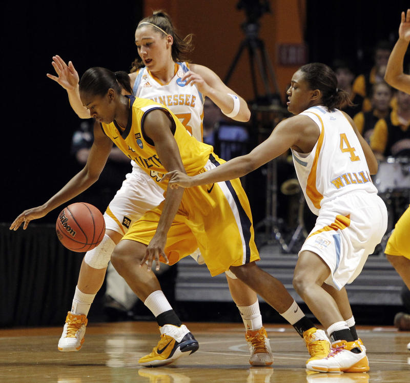 Marquette forward Sarina Simmons, left, is pressured by Tennessee defenders Taber Spani, center, and Kamiko Williams (4) during the first half of a second-round game in the NCAA college basketball tournament on Monday, March 21, 2011, in Knoxville, Tenn. (AP Photo/Mark Humphrey)