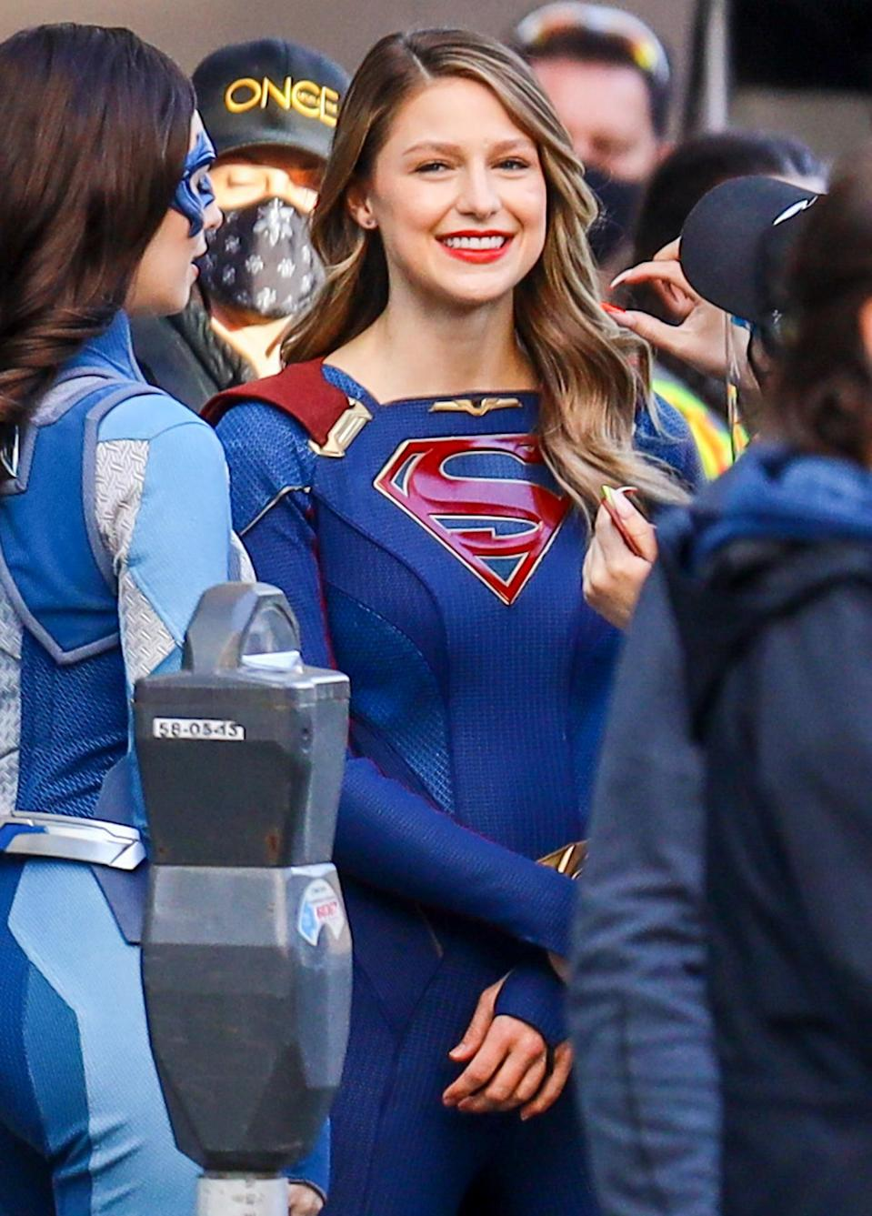 <p>Melissa Benoist smiles in full costume while prepping to film <em>Supergirl</em> in Vancouver on Monday.</p>