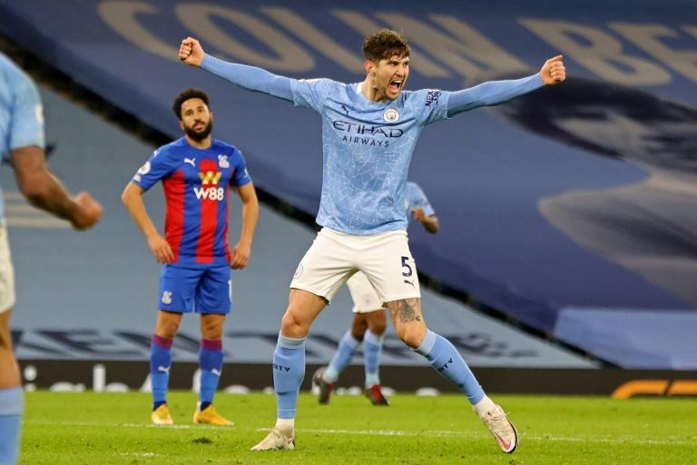Hail Stones: John Stones (right)scored his first two Premier League goals for Manchester City in a 4-0 win over Crystal Palace