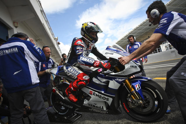 Spanish Rider Jorge Lorenzo leaves the pits with his Yamaha during the Moto GP qualifying practice of the Portuguese Grand Prix, in Estoril, outskirts of Lisbon, on May 5, 2012. AFP PHOTO / PATRICIA DE MELO MOREIRAPATRICIA DE MELO MOREIRA/AFP/GettyImages