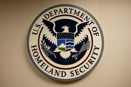 FILE PHOTO: U.S. Department of Homeland Security emblem is pictured at the National Cybersecurity & Communications Integration Center in Arlington