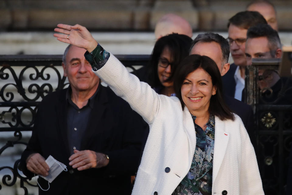 Paris mayor Anne Hidalgo arrives before delivering a speech after her victorious second round of the municipal election, Sunday, June 28, 2020 in Paris. France on Sunday held the second round of municipal elections that has seen a record low turnout amid concerns over the coronavirus outbreak and anger at how President Emmanuel Macron's government handled it. (AP Photo/Christophe Ena)