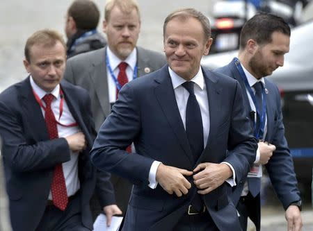 European Council President Donald Tusk, accompanied by his security detail, arrives at a European People's Party (EPP) meeting ahead of a EU summit in Brussels, Belgium, March 9, 2017. REUTERS/Eric Vidal