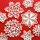 """<p>There's no more iconic winter craft project than fold-and-cut paper snowflakes — and nothing could be easier. Get design inspiration and take your flakes to the next level with templates from Omiyage Blogs. </p><p><em><a href=""""http://www.omiyageblogs.ca/2013/12/cut-fold-kirigami-snowflakes.html"""" rel=""""nofollow noopener"""" target=""""_blank"""" data-ylk=""""slk:Get the tutorial at Omiyage Blogs"""" class=""""link rapid-noclick-resp"""">Get the tutorial at Omiyage Blogs</a></em></p>"""