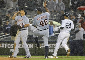 First baseman Miguel Cabrera (left) and closer Jose Valverde celebrate as Robinson Cano is retired for the final out of Detroit's 5-3 win in Game 2