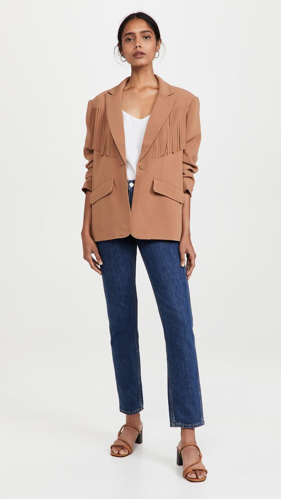 <p>This <span>Cinq a Sept Dani Blazer</span> ($595) is impossibly cool. The back has fringe too, which you know we love.</p>