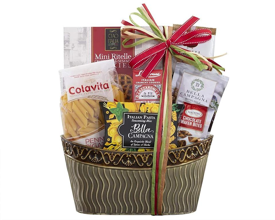 """<p><strong>Wine Country Gift Baskets</strong></p><p>amazon.com</p><p><strong>$39.35</strong></p><p><a href=""""https://www.amazon.com/dp/B009LHPJBI?tag=syn-yahoo-20&ascsubtag=%5Bartid%7C10070.g.35756207%5Bsrc%7Cyahoo-us"""" rel=""""nofollow noopener"""" target=""""_blank"""" data-ylk=""""slk:SHOP NOW"""" class=""""link rapid-noclick-resp"""">SHOP NOW</a></p><p>For a taste of Italy without leaving home, this pasta basket comes with seasoning mix, olives, penne pasta, cookies, taralli rings, olive oil, and chocolate truffles. </p>"""