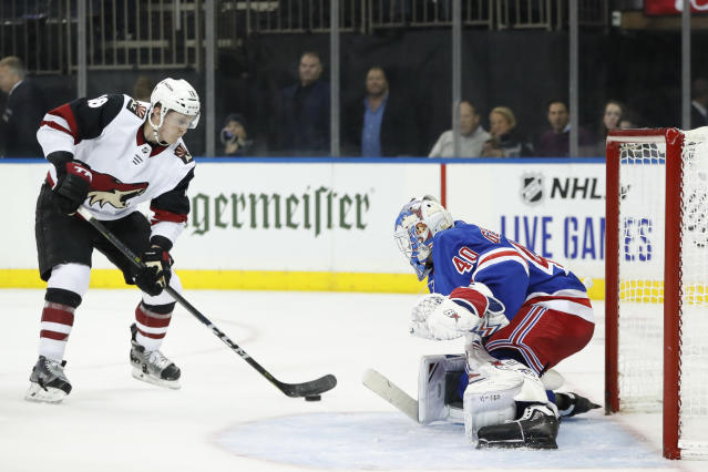 Arizona Coyotes left wing Christian Dvorak (18) looks to shoot against New York Rangers goaltender Alexandar Georgiev (40) during the first period of an NHL hockey game Tuesday, Oct. 22, 2019, in New York. (AP Photo/Kathy Willens)