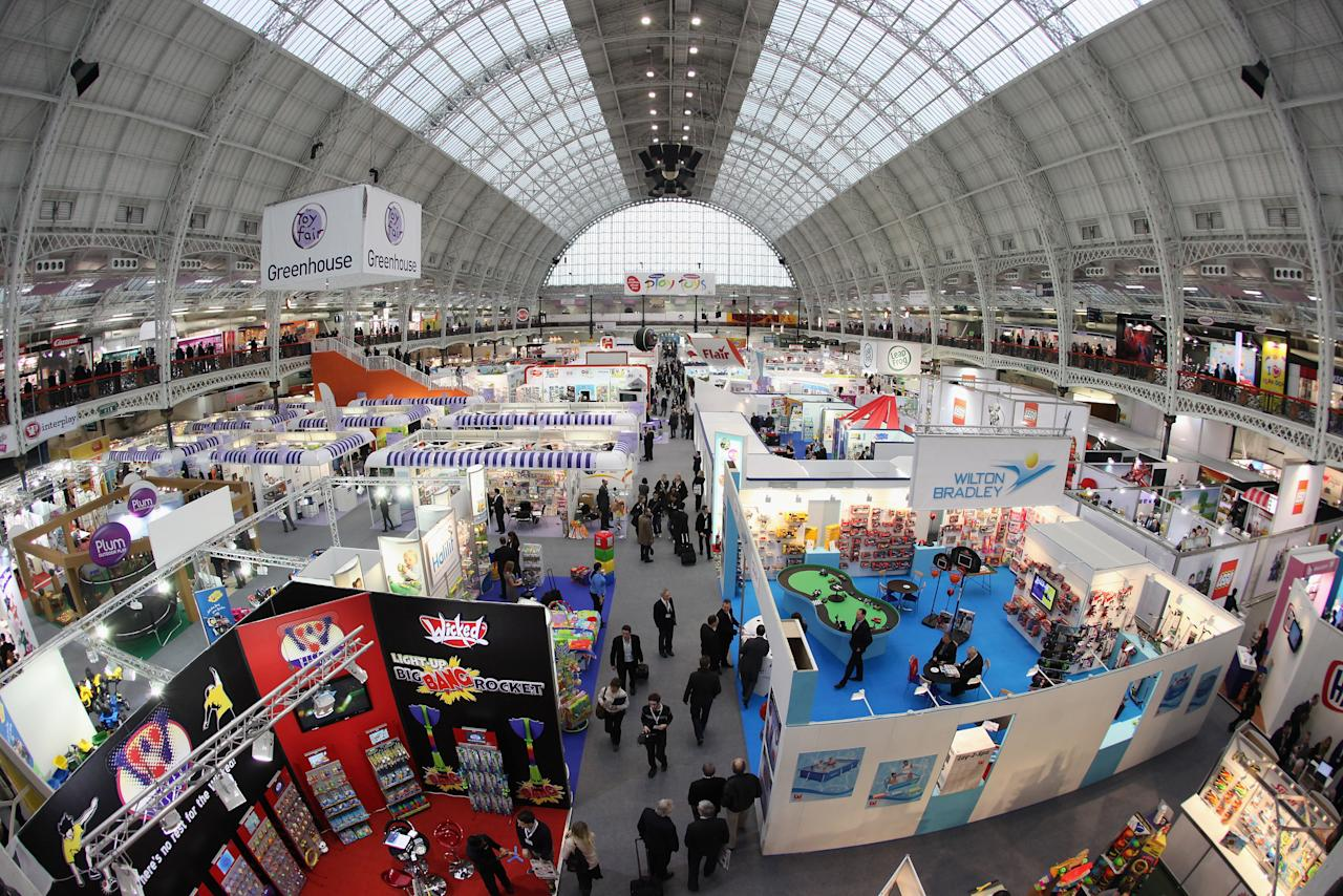 LONDON, ENGLAND - JANUARY 24:  An elevated view as toy industry retailers and manufacturers attend the 2012 London Toy Fair at Olympia Exhibition Centre on January 24, 2012 in London, England. The annual fair which is organised by the British Toy and Hobby Association, brings together toy manufacturers with retailers from around the world.  (Photo by Oli Scarff/Getty Images)