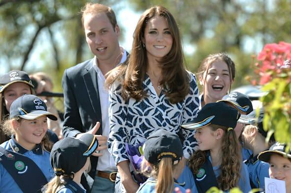 The Duke and Duchess of Cambridge pose with Winmalee Girl Guides after planting a Summer Red Eucalyptus at Winmalee Guide Hall in Yellow Rock during the eleventh day of their official tour to New Zealand and Australia. PRESS ASSOCIATION Photo. Picture date: Thursday April 17, 2014. See PA story ROYAL Tour. Photo credit should read: Anthony Devlin/PA Wire
