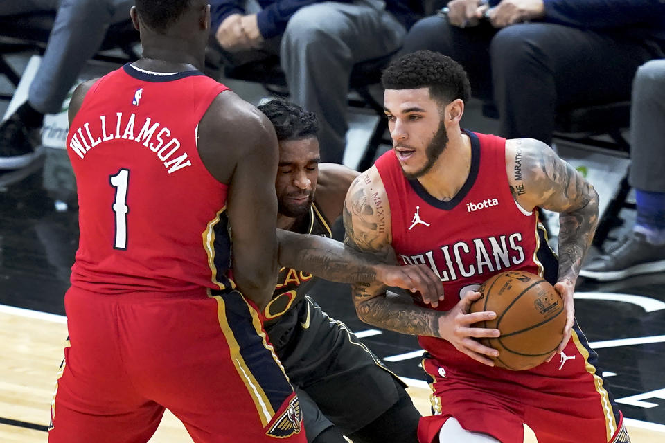 Chicago Bulls' Coby White, middle, tries to get past the screen set by New Orleans Pelicans' Zion Williamson, left, for Lonzo Ball during the first half of an NBA basketball game Wednesday, Feb. 10, 2021, in Chicago. (AP Photo/Charles Rex Arbogast)