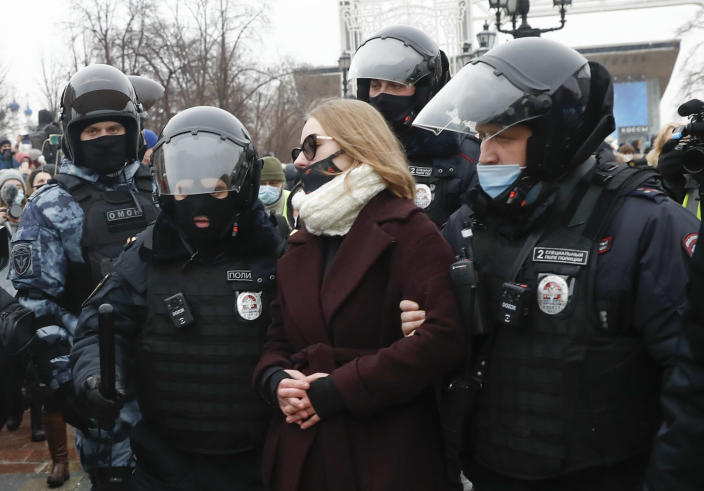 Police detain a woman during a protest against the jailing of opposition leader Alexei Navalny in Moscow, Russia, Saturday, Jan. 23, 2021. Russian police are arresting protesters demanding the release of top Russian opposition leader Alexei Navalny at demonstrations in the country's east and larger unsanctioned rallies are expected later Saturday in Moscow and other major cities. (AP Photo/Pavel Golovkin)
