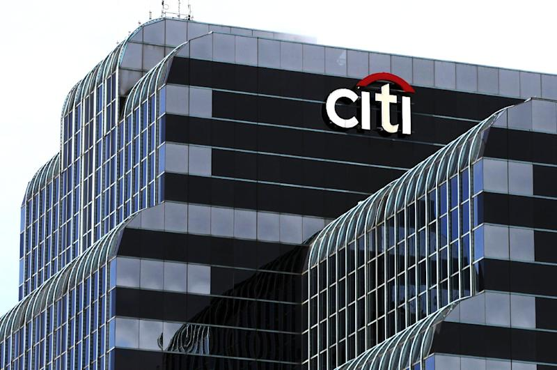 Citi Bank sign is seen, Wednesday, Dec. 5, 2012 in Chicago. Citigroup said Wednesday that it will cut 11,000 jobs, a bold early move by new CEO Michael Corbat. The cuts amount to about 4 percent of Citi's workforce of 262,000. (AP Photo/Kiichiro Sato)