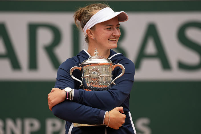 Czech Republic's Barbora Krejcikova holds her trophy after defeating Russia's Anastasia Pavlyuchenkova in their final match of the French Open tennis tournament at the Roland Garros stadium Saturday, June 12, 2021 in Paris. The unseeded Czech player defeated Anastasia Pavlyuchenkova 6-1, 2-6, 6-4 in the final. (AP Photo/Michel Euler)