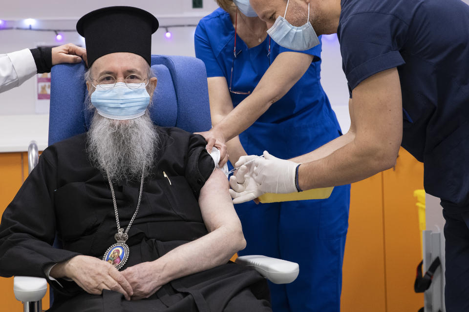 Metropolitan Hierotheos of Nafpaktos and Agios Vlasios receives an injection with a dose of COVID-19 vaccine, at Evangelismos hospital, in Athens, Sunday, Dec. 27, 2020. Doctors, nurses and the elderly rolled up their sleeves across the European Union to receive the first doses of the coronavirus vaccine Sunday in a symbolic show of unity and moment of hope for a continent confronting its worst health care crisis in a century. (Alkis Konstantinidis/Pool via AP)