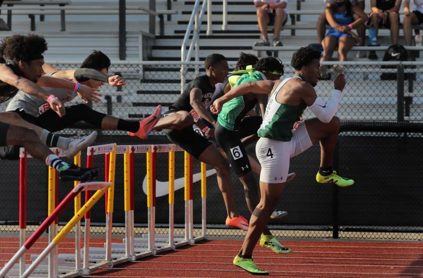 Stockton St. Mary's Jadyn Marshall (4) takes the early lead in winning the 110-meter hurdles at the Arcadia Invitational.