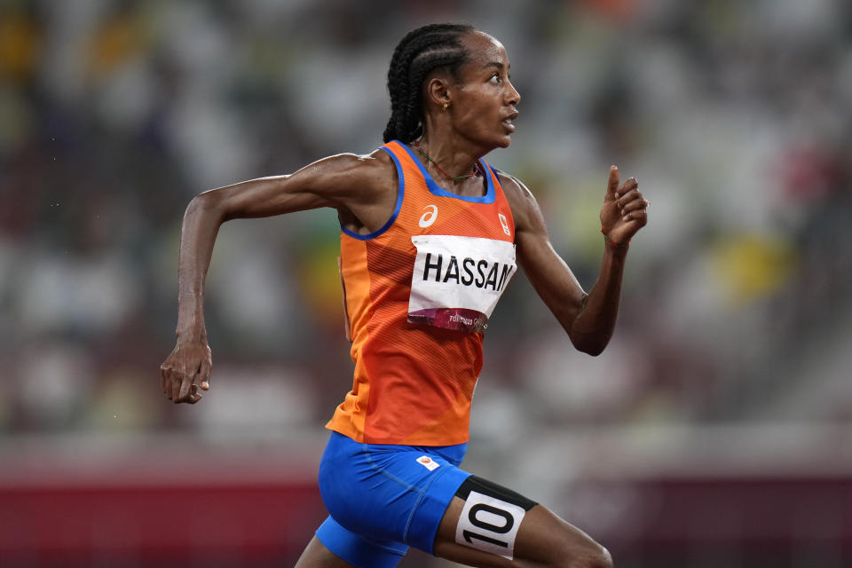 Sifan Hassan, of the Netherlands, runs to the finish line to win the women's 5,000-meters final at the 2020 Summer Olympics, Monday, Aug. 2, 2021, in Tokyo. (AP Photo/Francisco Seco)