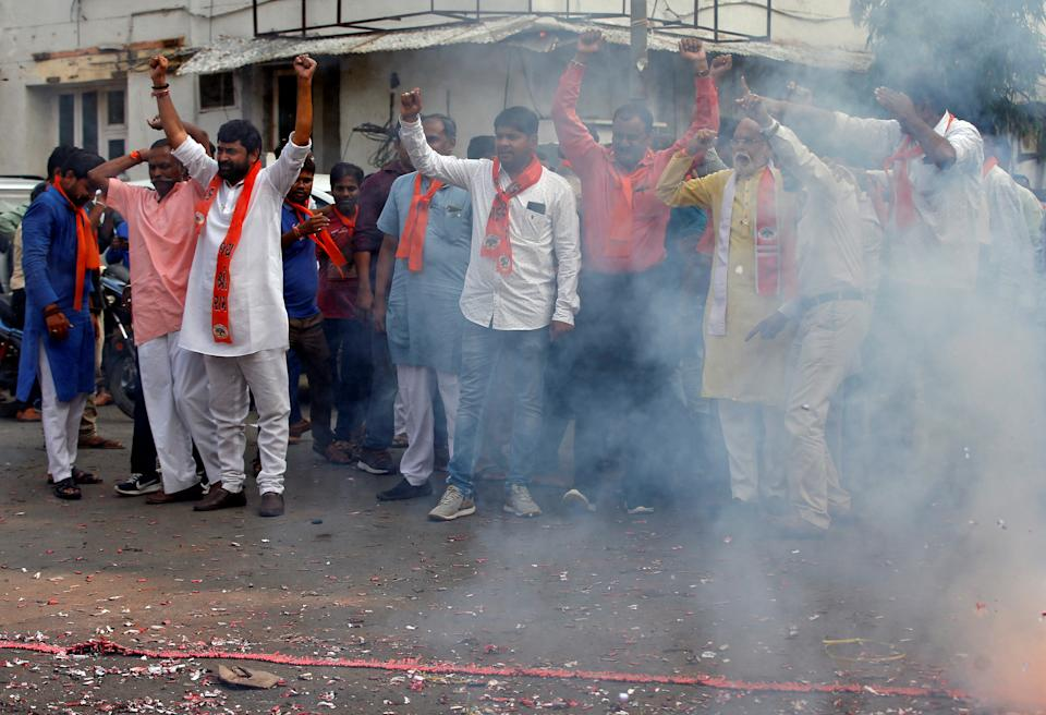 Supporters of the Vishva Hindu Parishad (VHP), a Hindu nationalist organisation, burn firecrackers to celebrate after Supreme Court's verdict on a disputed religious site in Ayodhya, in Ahmedabad, India, November 9, 2019. REUTERS/Amit Dave