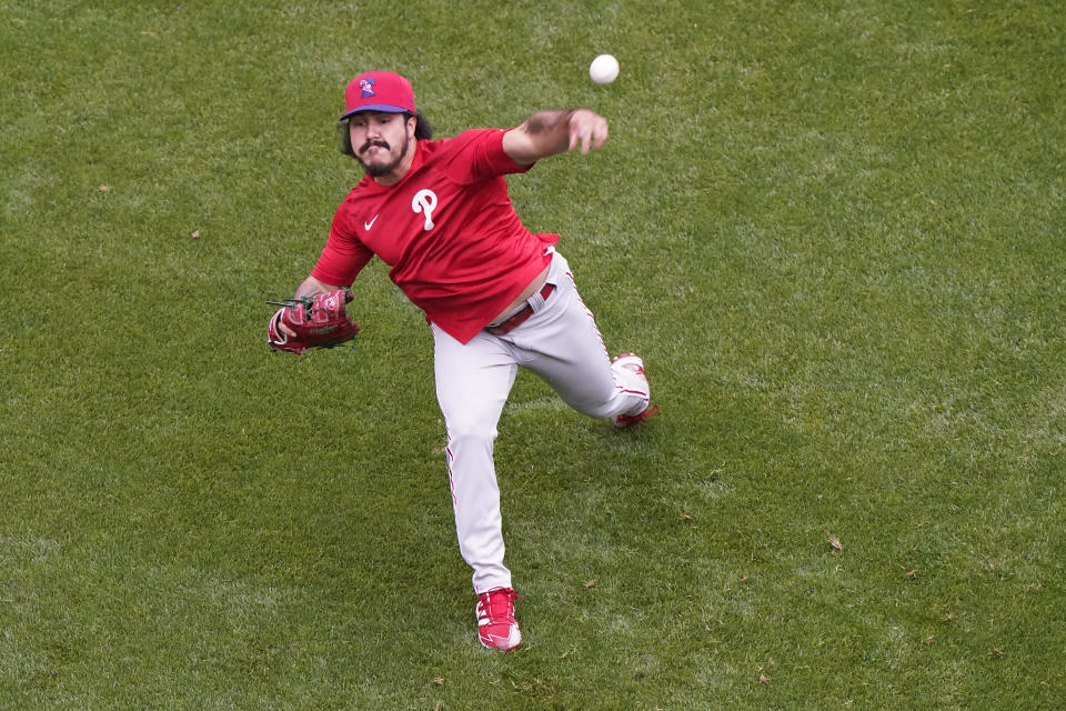 Philadelphia Phillies starting pitcher JoJo Romero throws in the outfield at Citi Field after a baseball game against the New York Mets was postponed due to rainy weather, Monday, April 12, 2021, in New York. (AP Photo/Kathy Willens)