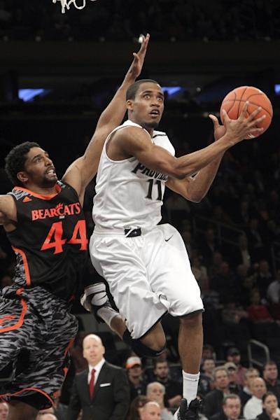 Providence's Bryce Cotton (11) goes up past Cincinnati's JaQuon Parker (44) during the first half of an NCAA college basketball game at the Big East Conference tournament, Wednesday, March 13, 2013 in New York. (AP Photo/Mary Altaffer)