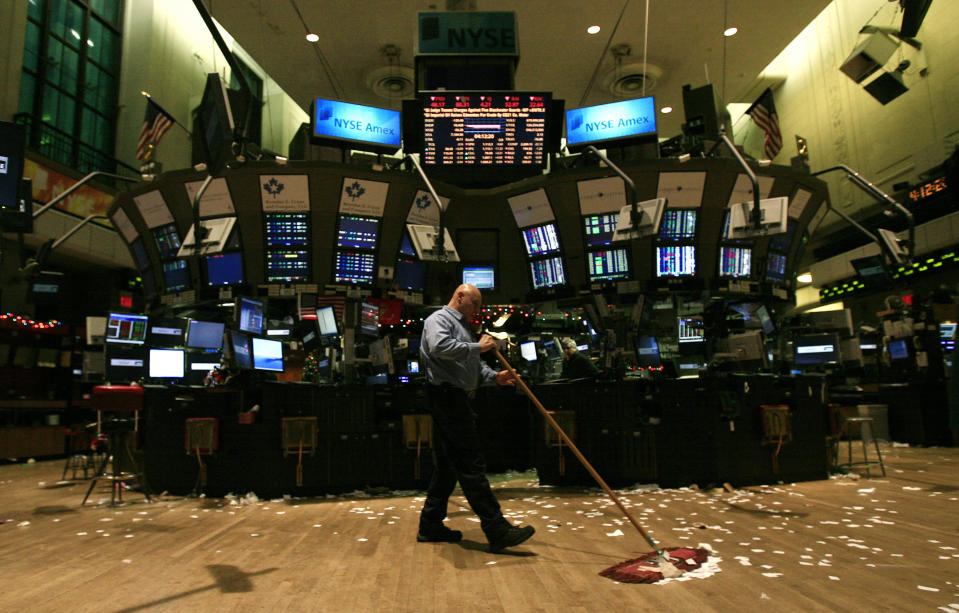 A Worker Sweeps the Floor of the New York Stock Exchange - Brands: TODAY'S BUSINESS PHOTOS)