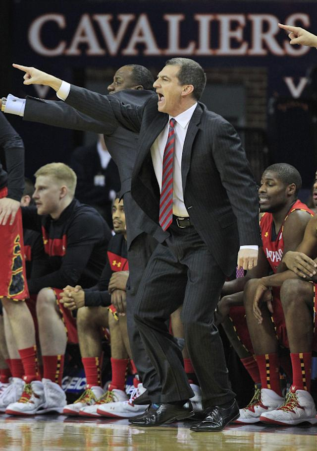 Maryland head coach Mark Turgeon directs his team during the first half of an NCAA college basketball game in Charlottesville, Va., Monday, Feb. 10, 2014. (AP Photo/Steve Helber)