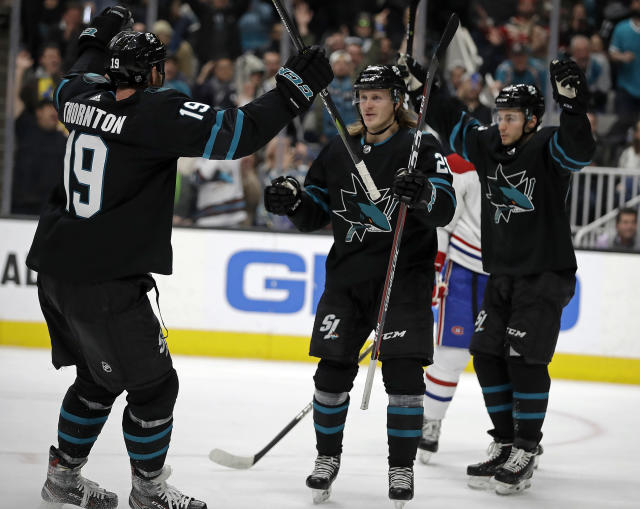 San Jose Sharks' Marcus Sorensen, center, celebrates with Joe Thornton (19) and Kevin Labanc, right, after scoring a goal against the Montreal Canadiens during the first period of an NHL hockey game Thursday, March 7, 2019, in San Jose, Calif. (AP Photo/Ben Margot)