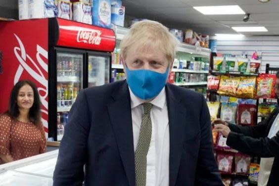Boris Johnson was first pictured wearing a mask only last week (Downing Street)