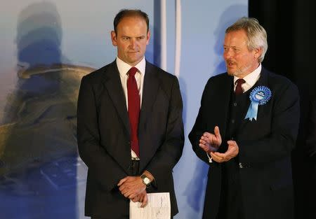 United Kingdom Independence Party (UKIP) candidate Douglas Carswell (L) reacts next to the Conservative Party candidate Giles Watling after winning the by-election in Clacton-on-Sea in eastern England October 10, 2014. REUTERS/Stefan Wermuth