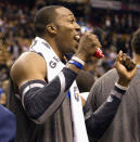 Orlando Magic's Dwight Howard gestures to the crowd after winning their NBA basketball game against the Toronto Raptors in Toronto March 26, 2012. REUTERS/Fred Thornhill (CANADA - Tags: SPORT BASKETBALL)
