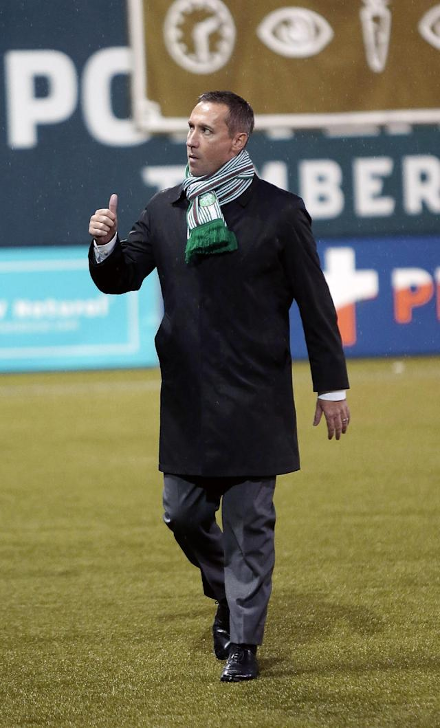 Portland Timbers coach Caleb Porter gives a thumbs up to the crowd as he walks onto the field an MLS soccer game against the Philadelphia Union in Portland, Ore., Saturday, March 8, 2014. (AP Photo/Don Ryan)