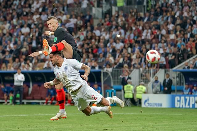 <p>Ivan Perisic of Croatia beats Kyle Walker to the cross with a high foot scoring for 1-1 in the 68th minute (photo by Ulrik Pedersen/Action Plus via Getty Images) </p>
