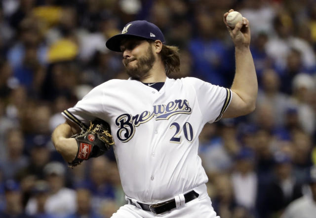 FILE - In this Oct. 19, 2018, file photo, Milwaukee Brewers starting pitcher Wade Miley throws during the first inning of Game 6 of the National League Championship Series baseball game against the Los Angeles Dodgers in Milwaukee. The Houston Astros filled an opening in their rotation, agreeing to a $4.5 million, one-year contract with 32-year-old left-hander Miley. (AP Photo/Matt Slocum, File)