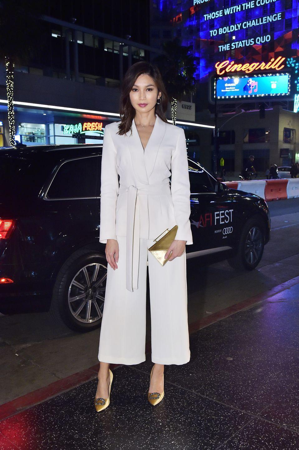<p>Chan wore a norm-core jumpsuit and metallic gold heels, for the closing night of the American Film Institute Festival in 2018</p>