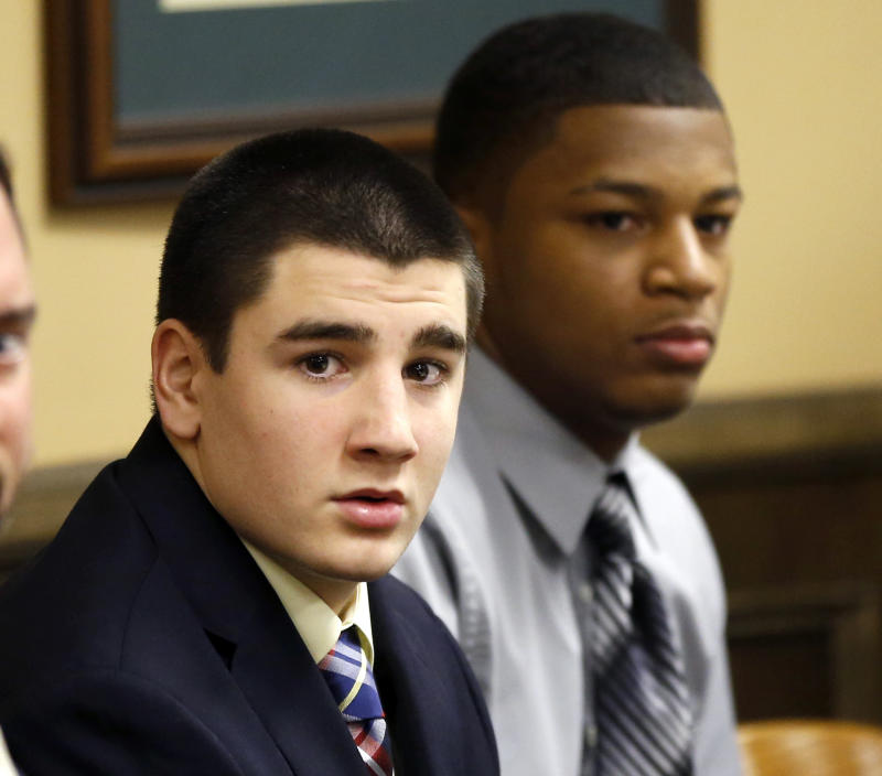 FILE - In this March 13, 2013 file photo, Trent Mays,  left, and Ma'lik Richmond sit at the defense table before the start of their trial on rape charges in juvenile court in Steubenville, Ohio. Judge Thomas Lipps, who sentenced the pair to  juvenile detention after convicting them of raping a West Virginia girl in 2012, will hold a hearing Friday, June 14, 2013, as a first step for the two teen defendants to be transferred from a state juvenile detention center to a facility that works with sex offenders. (AP Photo/Keith Srakocic, Pool)