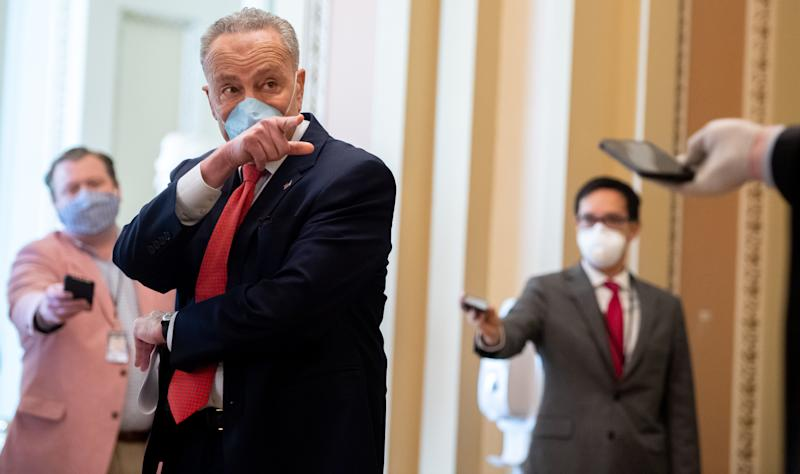 US Senate Minority Leader Chuck Schumer, Democrat of New York, wears a mask to protect himself and others from COVID-19, known as coronavirus, as he speaks to the press as the Senate returns into session at the US Capitol in Washington, DC, May 4, 2020. (Photo by SAUL LOEB / AFP) (Photo by SAUL LOEB/AFP via Getty Images)