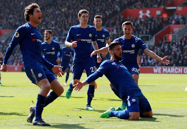 """Soccer Football - Premier League - Southampton vs Chelsea - St Mary's Stadium, Southampton, Britain - April 14, 2018 Chelsea's Olivier Giroud celebrates scoring their third goal with Marcos Alonso, Cesar Azpilicueta and team mates REUTERS/Ian Walton EDITORIAL USE ONLY. No use with unauthorized audio, video, data, fixture lists, club/league logos or """"live"""" services. Online in-match use limited to 75 images, no video emulation. No use in betting, games or single club/league/player publications. Please contact your account representative for further details. TPX IMAGES OF THE DAY"""