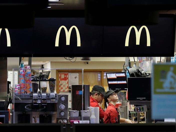Fast food restaurant workers prepare food for drive through customers as level four COVID 19 restrictions are eased in Christchurch, New Zealand, on April 27, 2020.