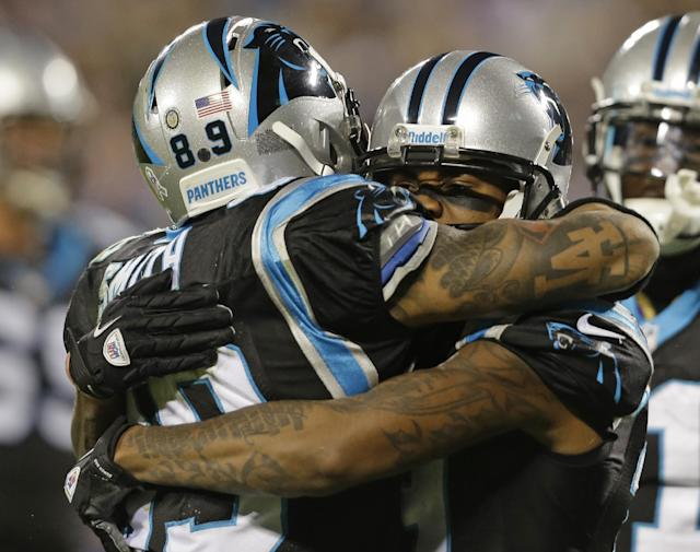 Carolina Panthers' Ted Ginn, right, is congratulated by Steve Smith, left, after a touchdown catch against the New England Patriots during the second half of an NFL football game in Charlotte, N.C., Monday, Nov. 18, 2013. (AP Photo/Gerry Broome)