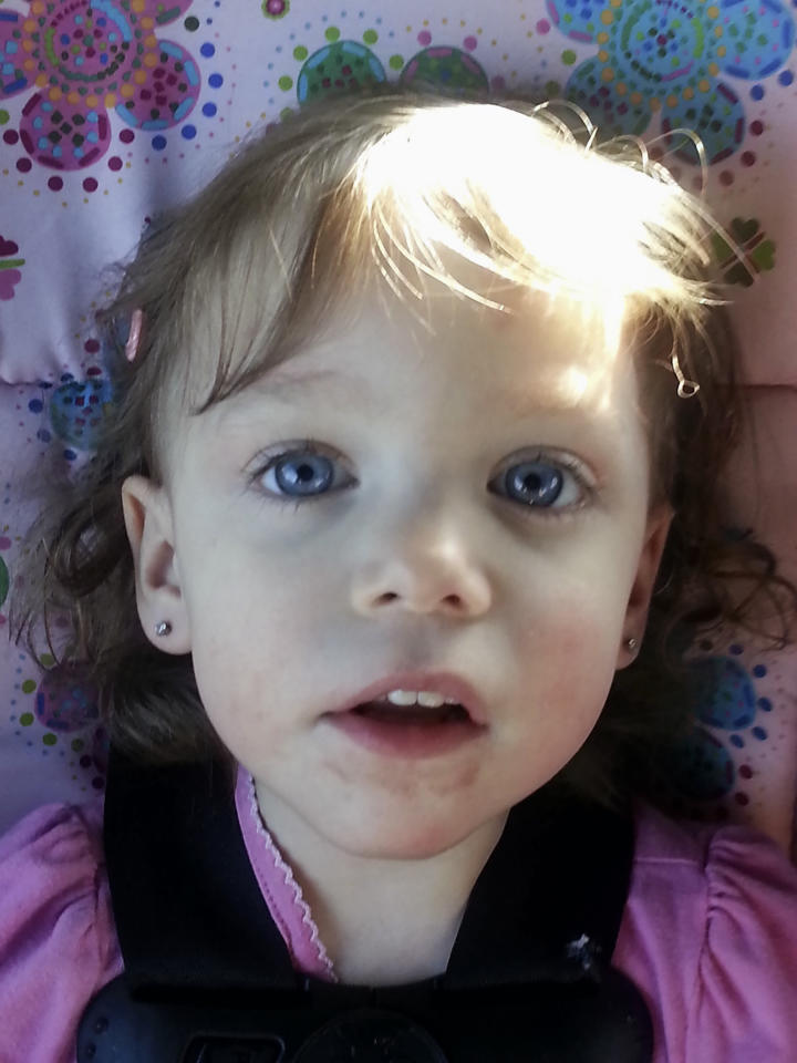 This undated photo provided by Shauna Etheredge shows her granddaughter, Londyn Raine Robinson Sack, in Terryville, Conn., shortly before Londyn died on Oct. 19, 2014, after ingesting an opioid that her mother obtained. Her mother is incarcerated on a charge of second-degree manslaughter. The number of children's deaths is still small relative to the overall toll from opioids, but toddler fatalities have climbed steadily over the last 10 years. (Shauna Etheredge via AP)