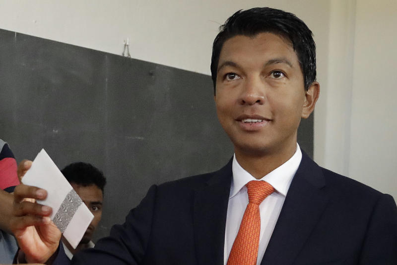 FILE - In this Dec. 19, 2018 file photo, presidential candidate Andry Rajoelina casts his ballot during a runoff presidential election in Antananarivo, Madagascar. On Friday, May 1, 2020, The Associated Press reported on stories circulating online incorrectly asserting that Madagascar is the first country to succeed in finding a cure for COVID-19. President Rajoelina has been promoting an herbal drink called Covid Organics as a remedy for COVID-19, but there's no scientific evidence to show it's effective. (AP Photo/Themba Hadebe)