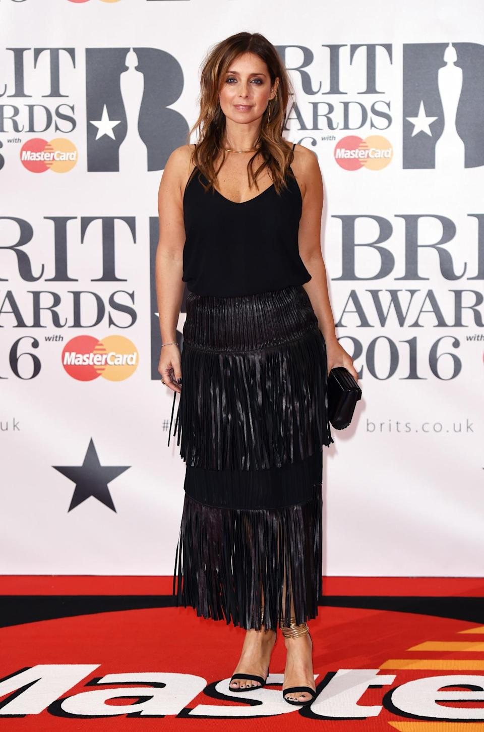 <p>The star donned a fringed leather skirt and matching accessories. <i>[Photo: Rex]</i></p>