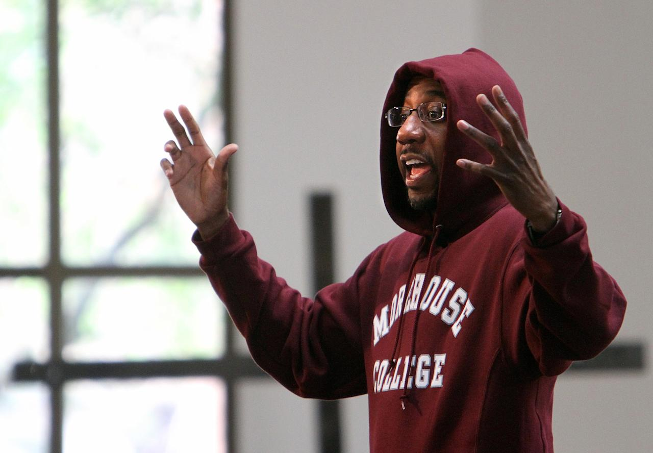 Rev. Raphael Warnock wears a hoodie during his morning sermon at the Ebenezer Baptist Church on Sunday, March 25, 2012, in Atlanta. Church-goers were invited to wear hoodies to services to show their support for justice in the case of Trayvon Martin, an unarmed black teenager who was wearing a hoodie on the night he was killed by a neighborhood watch captain in Florida. (AP Photo/Atlanta Journal-Constitution, Vino Wong) MARIETTA DAILY OUT; GWINNETT DAILY POST OUT