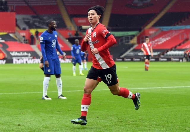Liverpool are considering offering Takumi Minamino in exchange for Lucas Ocampos (Neil Hall/PA)