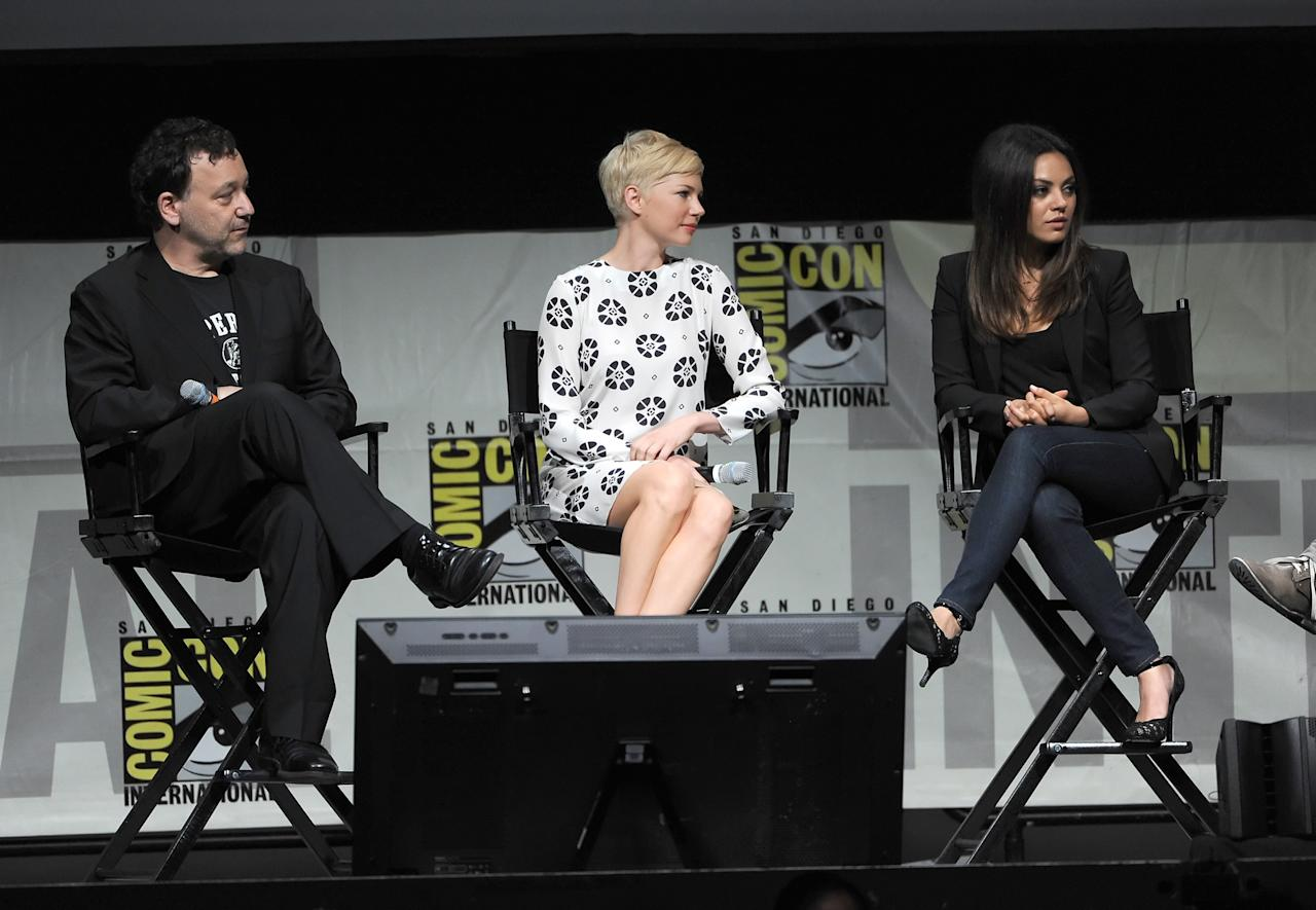 "SAN DIEGO, CA - JULY 12:  (L-R) Director Sam Raimi, actresses Michelle Williams, and Mila Kunis speak at the ""Oz: The Great and Powerful"" panel during Comic-Con International 2012 at San Diego Convention Center on July 12, 2012 in San Diego, California.  (Photo by Kevin Winter/Getty Images)"