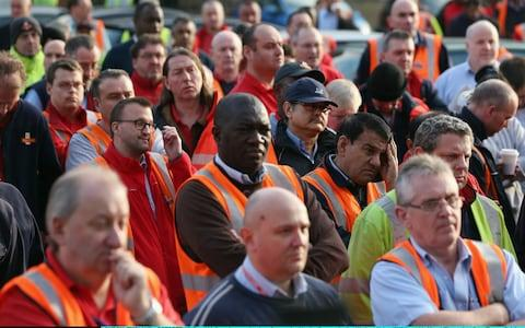 Royal Mail employees attend a rally organised by the CWU - Credit: Oli Scarff/Getty Images