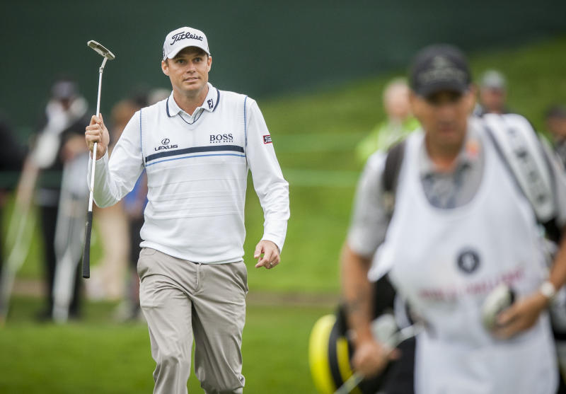 Nick Watney walks to the 18th green during the first round of the World Challenge golf tournament at Sherwood Country Club in Thousand Oaks, Calif., Thursday, Nov. 29, 2012. (AP Photo/Bret Hartman)