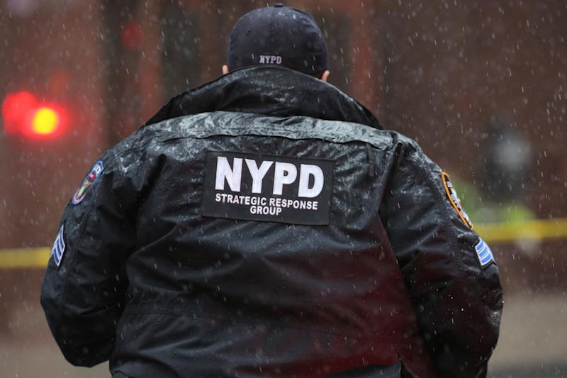 New York City Police Department (NYPD) officer arrives at 787 7th Avenue in midtown Manhattan where a helicopter was reported to have crashed in New York City, New York, June 10, 2019. (Photo: Brendan McDermid/Reuters)