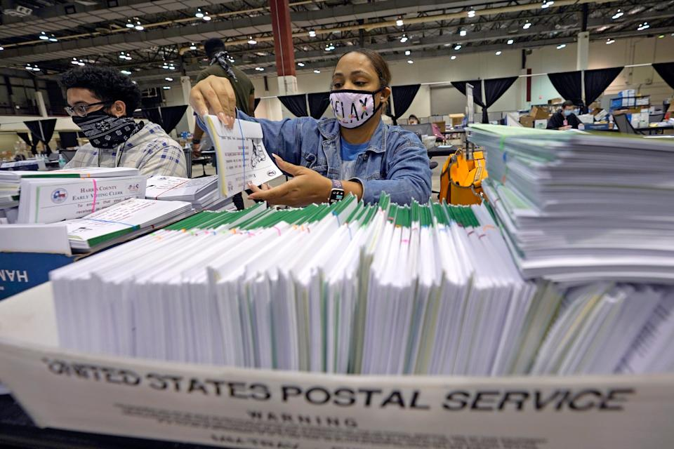 Harris County election worker Romanique Tillman prepares mail-in ballots to be sent out to voters on Sept. 29, 2020, in Houston, Texas.