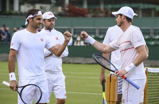 Roger Federer (left) practised with Andy Murray on Friday